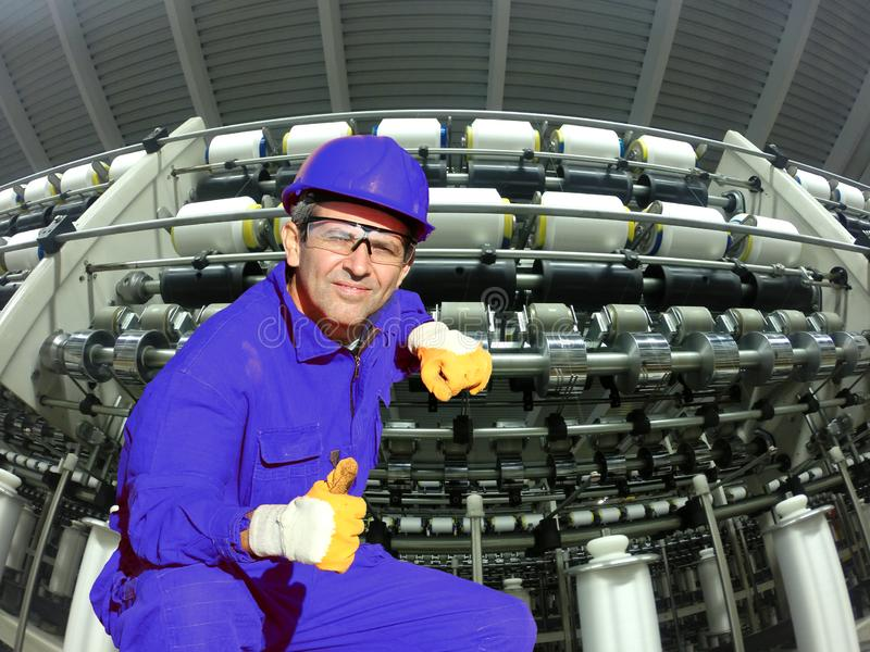 Industrial Worker In A Textile Factory Showing Ok Sign royalty free stock photography