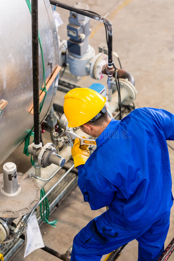 Download Industrial Worker Working At Machine Stock Image - Image of hardhat, production: 59101977