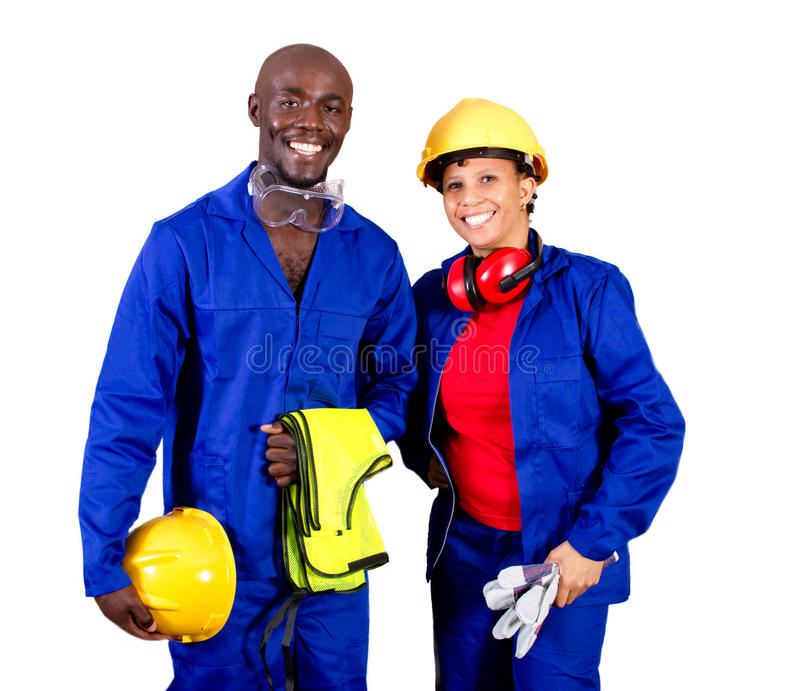 Industrial workers. Two happy african american industrial workers in full protective gear royalty free stock images
