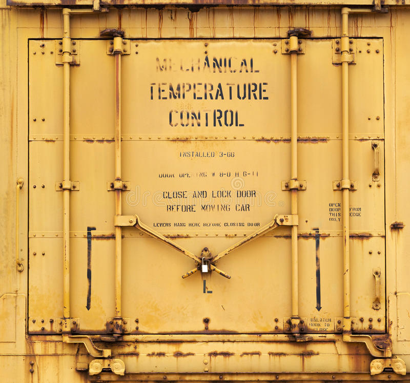 Industrial yellow door background. Grunge rusty yellow metal industrial door background royalty free stock photo