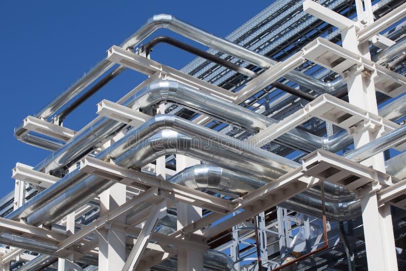 Industrial zone. Steel pipelines royalty free stock image