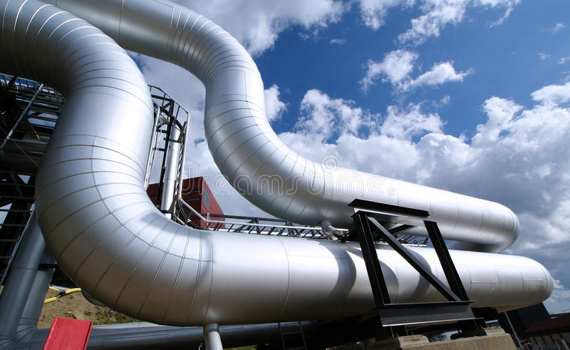 Industrial zone, Steel pipelines on blue sky royalty free stock images
