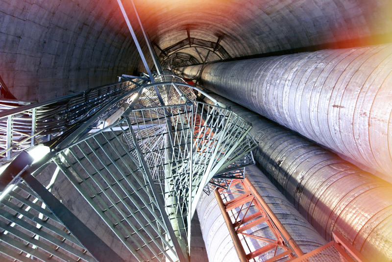 Industrial zone, Steel pipelines and smokestack royalty free stock images