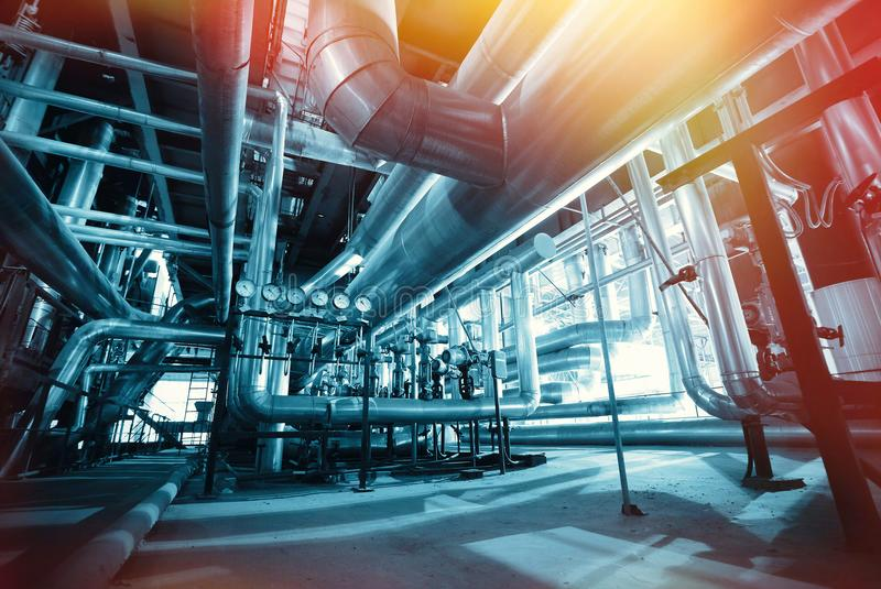 Industrial Steel pipelines, valves and ladders royalty free stock images