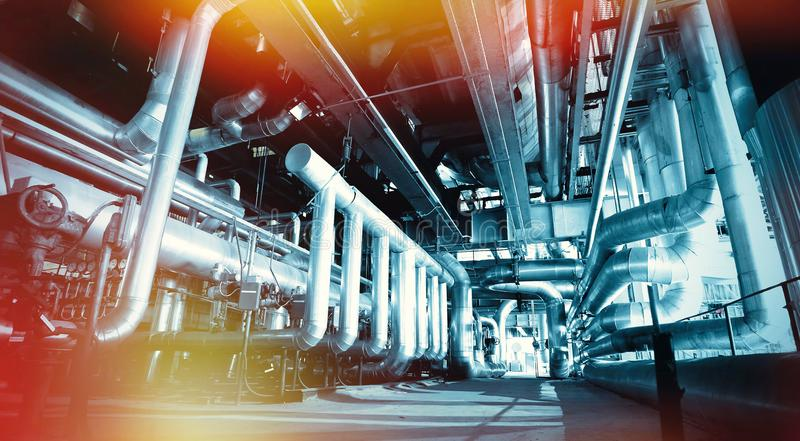 Industrial Steel pipelines, valves and ladders stock photos