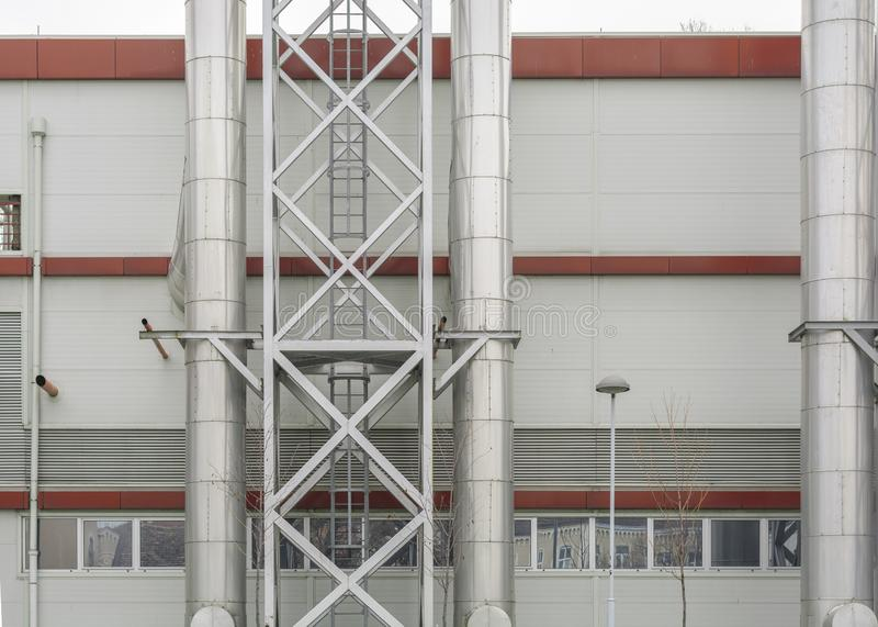 Industrial zone and steel pipelines, valves and ladders stock images