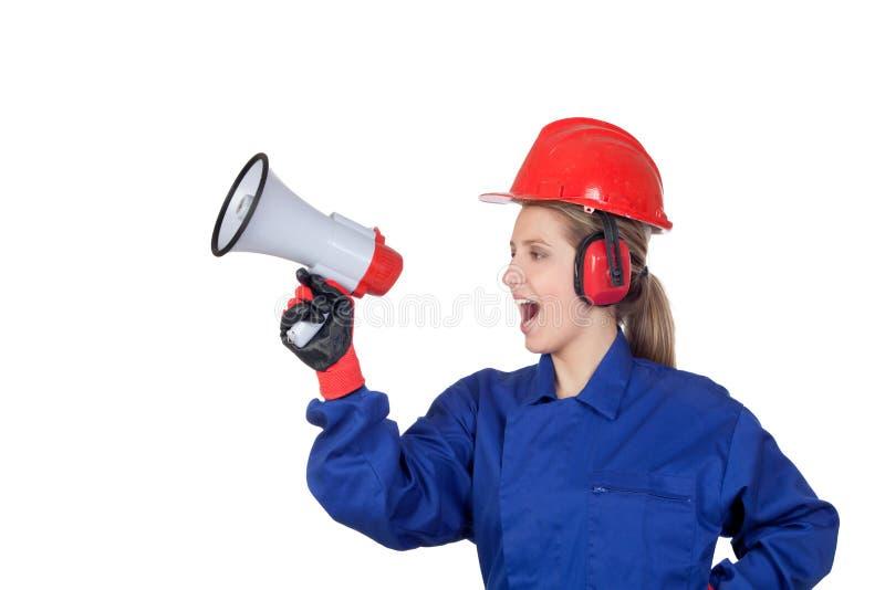 Industriarbetarekvinna med en megafon arkivfoto