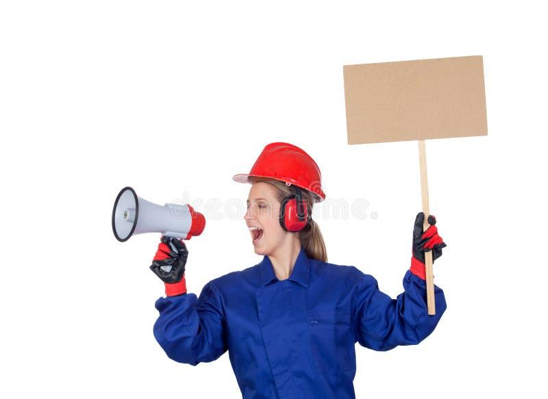 Industriarbetarekvinna med en megafon och en affisch royaltyfria foton
