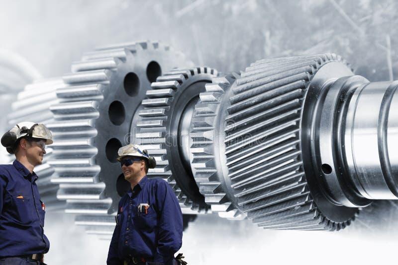 Industriearbeitskräfte und Technikteile lizenzfreie stockfotografie
