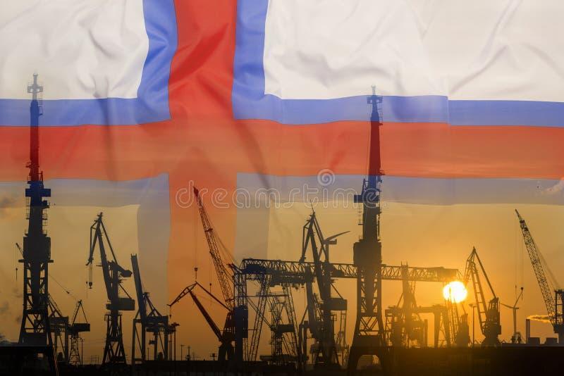 Industrieel concept met de vlag van de Faeröer bij zonsondergang royalty-vrije stock fotografie