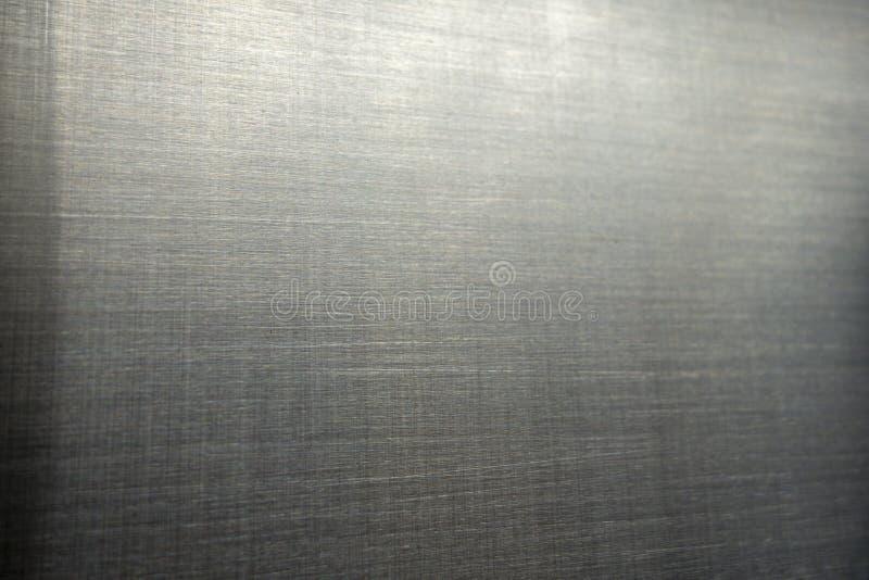 Industriell hård bakgrund för platta för metallrostfritt stålyttersida med borstade markes royaltyfri bild
