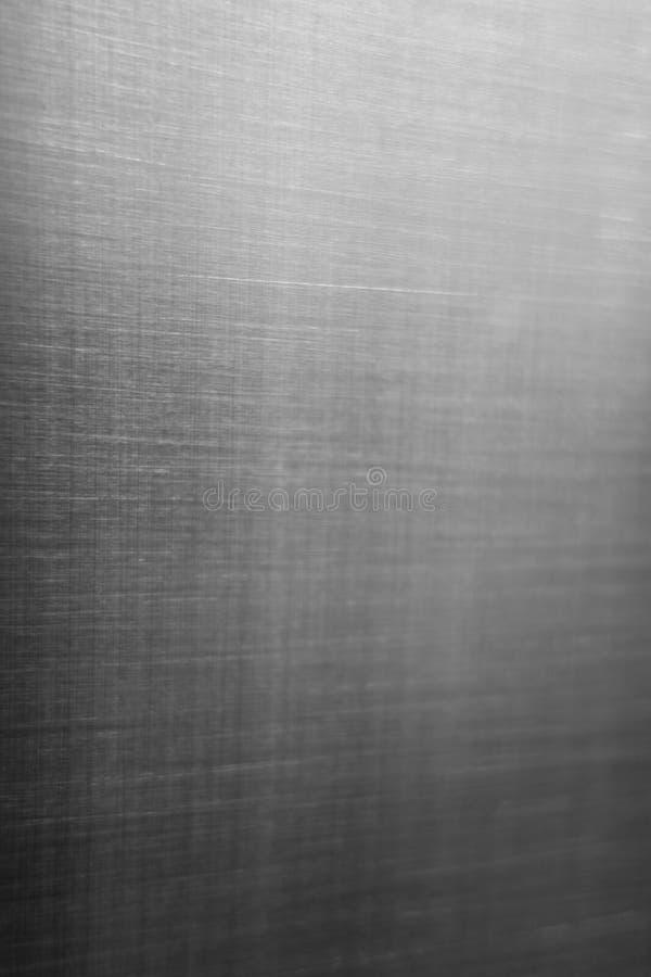 Industriell hård bakgrund för platta för metallrostfritt stålyttersida med borstade markes arkivfoto