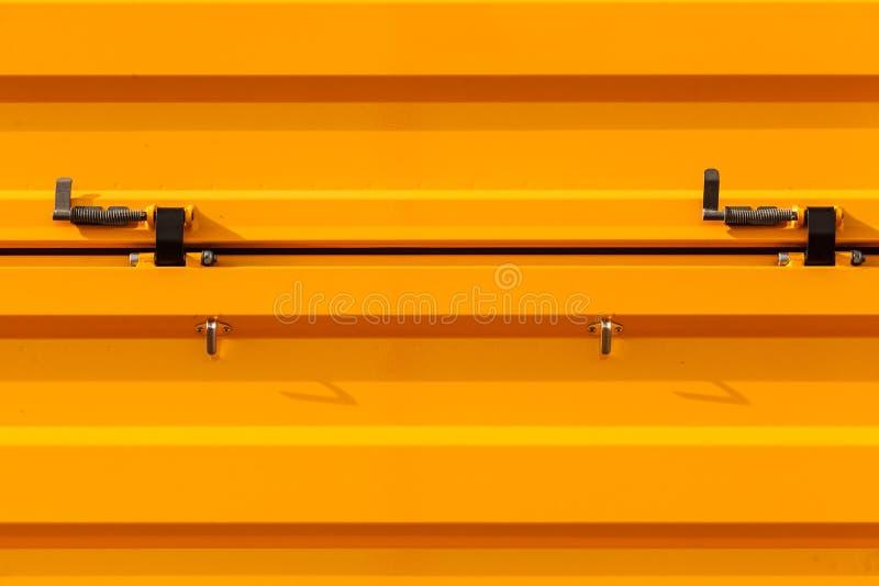 Industriell krabb orange tinware med metallbeståndsdelar royaltyfri bild