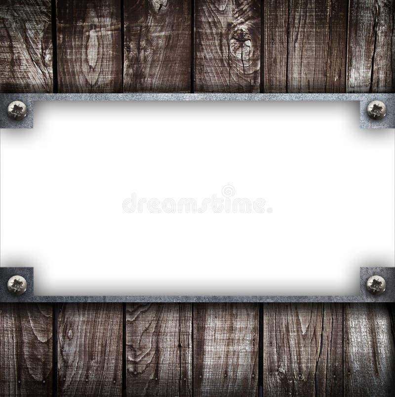 Industrielle Metallplatte auf einem h?lzernen Hintergrund lizenzfreie abbildung