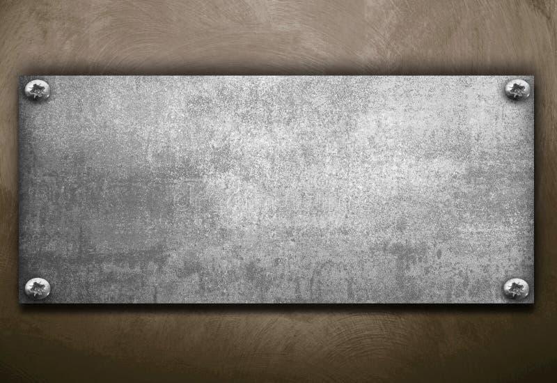 Industrielle Metallplatte auf einem Weinlesehintergrund stockbilder