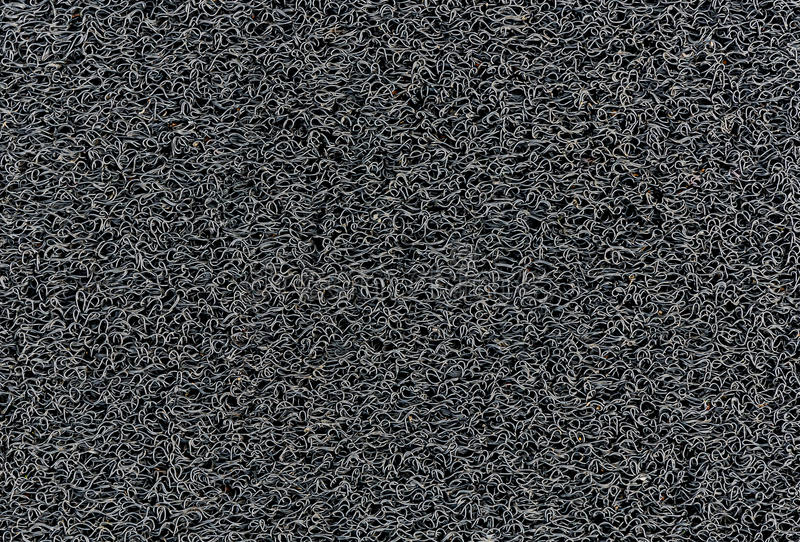 Industrielle schwarze Vinylteppich Spulen-Muster-Autofußmattebeschaffenheit stockfotografie