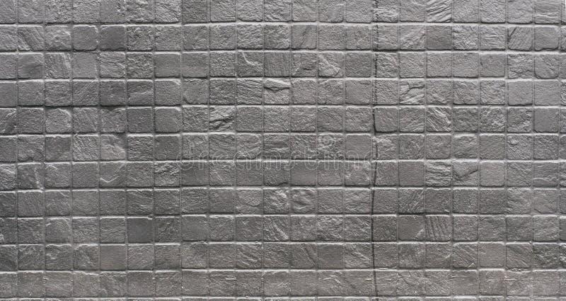 Industrielle silberne gemalte quadratische Backsteinmauer des Schmutzes lizenzfreie stockfotografie