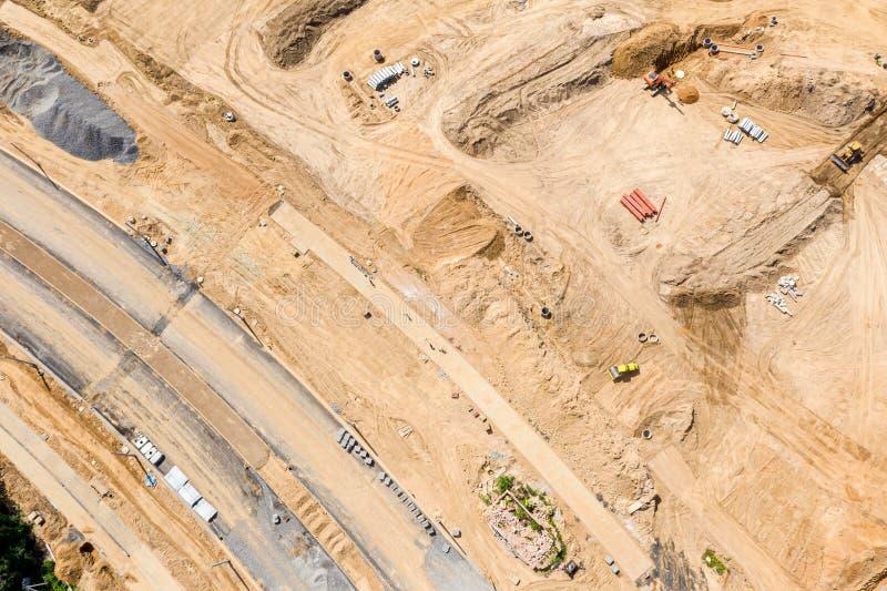 Industriemaschinen an der Baustelle Bodenverdichter, der Boden flachdrückt lizenzfreie stockbilder