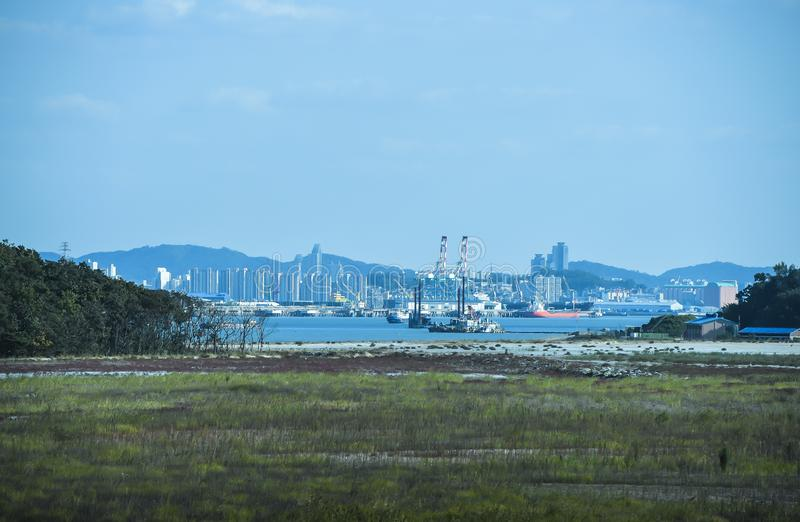 Industries. The view from the sea a cargo ship is heading to Incheon port, South Korea. at 04 October 2014 stock images