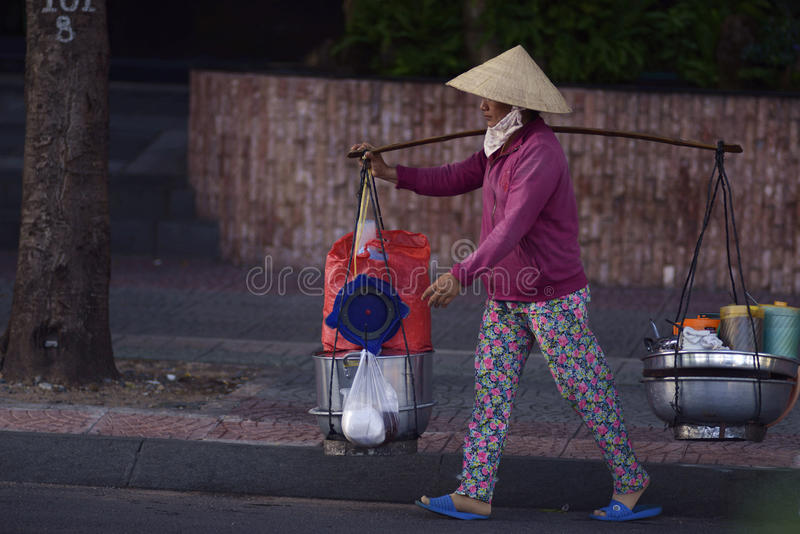 Industrious Vietnamese woman. Diligence of Vietnamese women, work in the street royalty free stock photo