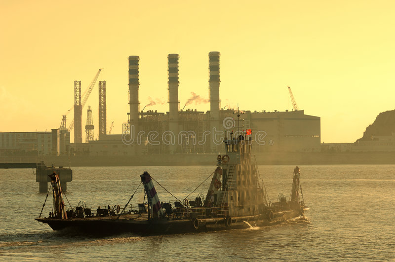 Industry. And a ship and sunset with pink sky stock photo