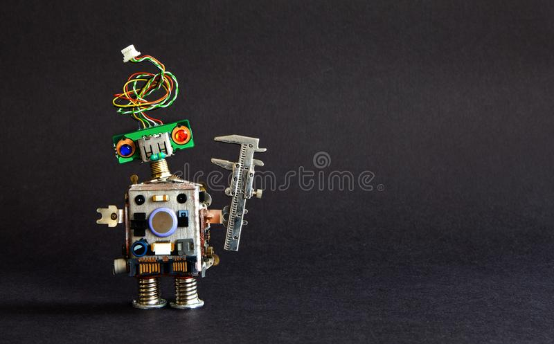 Industry 4.0 automation technology concept. Creative design robot engineer caliper on black background. Copy space photo.  stock photos