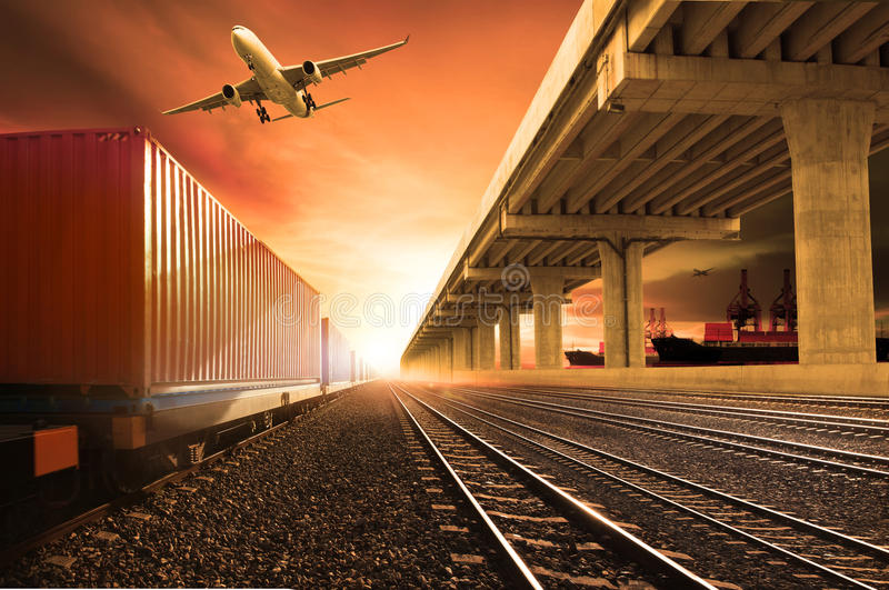 Industry container trains running on railways track cargo plane. Flying with land bridge transportation over ship port use for land ,air and ship transportation royalty free stock photos