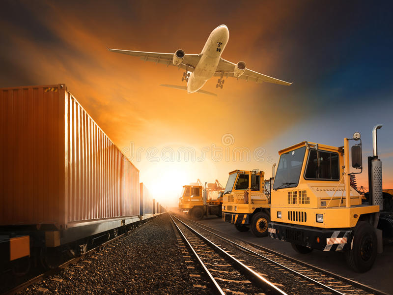 Industry container trainst running on railways track plane cargo. Flying above and ship transport in import export container yard royalty free stock images