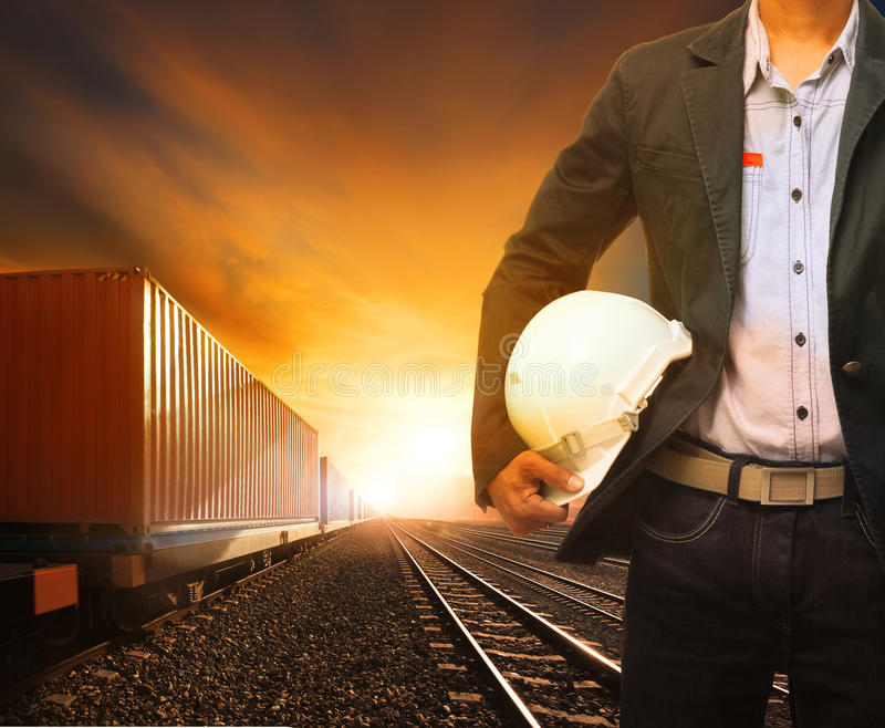 Industry container trainst running on railways track and working. Man use for land transport and logistic business royalty free stock images