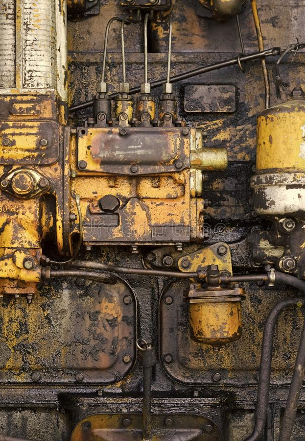 Industry, engineering, machine. Machinery with oil dirt on grunge metal background. Factory, manufacture equipment. Old technology, vintage Device tool gear royalty free stock images