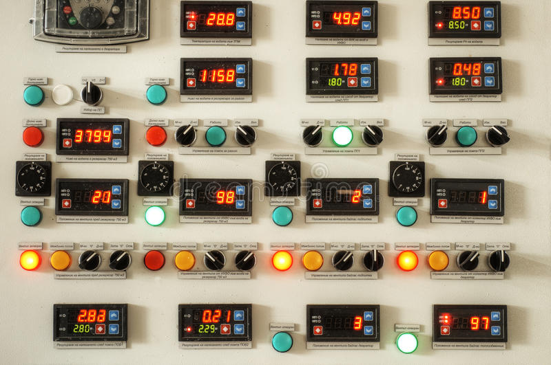 Industry factory control panel. With switches and digital indicators stock photo