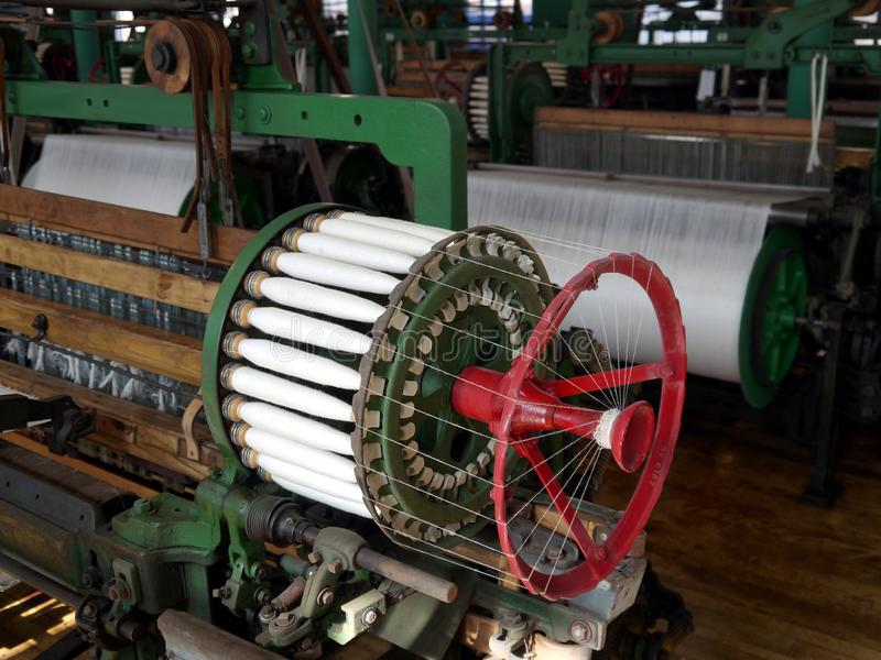 Industry: historic cotton mill spool machine stock images