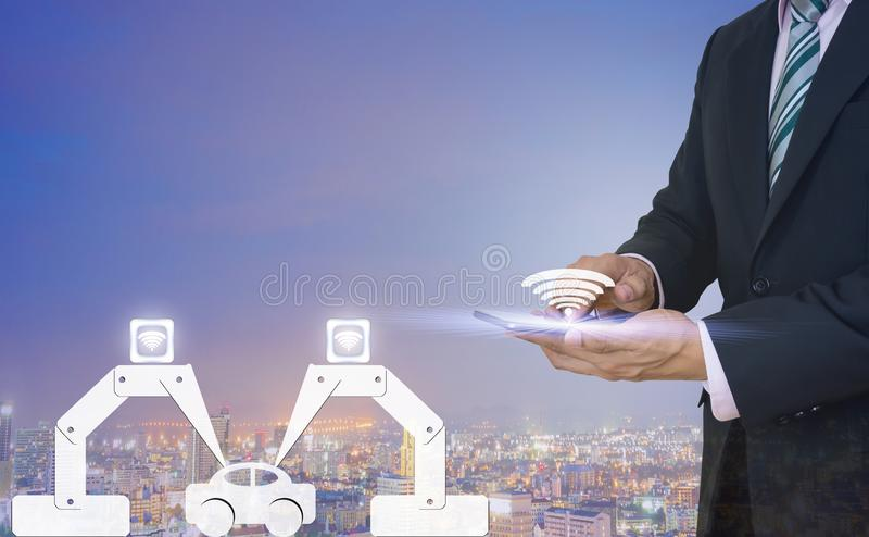 Industry 4.0 manufacture car using a robot of men hold stock image