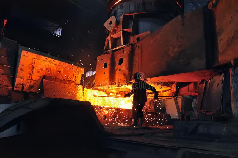 Industry metallurgical metallurgist at work. Heavy industry metallurgical metallurgist at work stock photography
