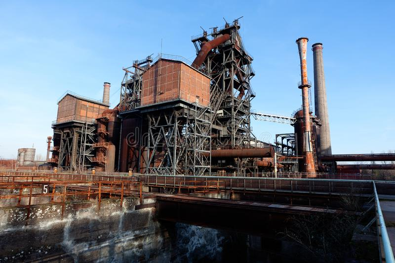 Industry steel iron oven blast furnace factory Landschaftspark, Duisburg, Germany. Industrial site of a steel blast furnace of the old and abandoned iron and royalty free stock photo