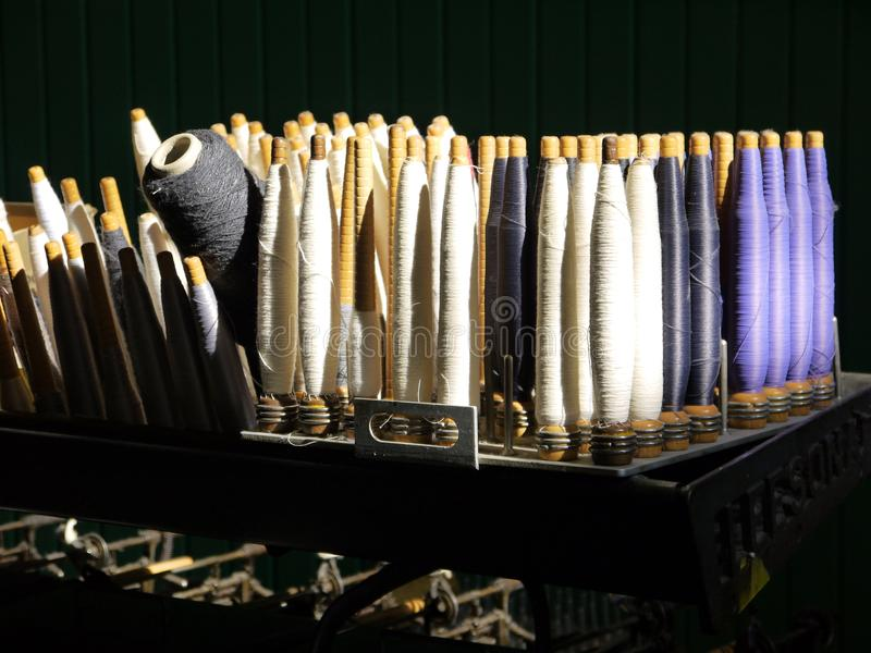 Industry: sunlit cotton spools royalty free stock image