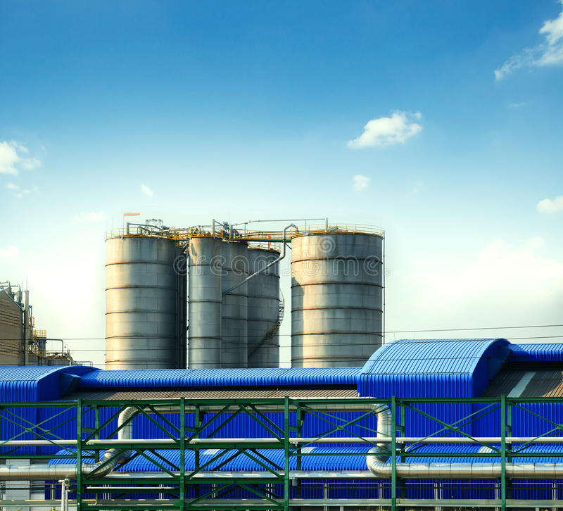 Industry tank strage in heavy industrial estate plant against be. Autiful blue sky stock image