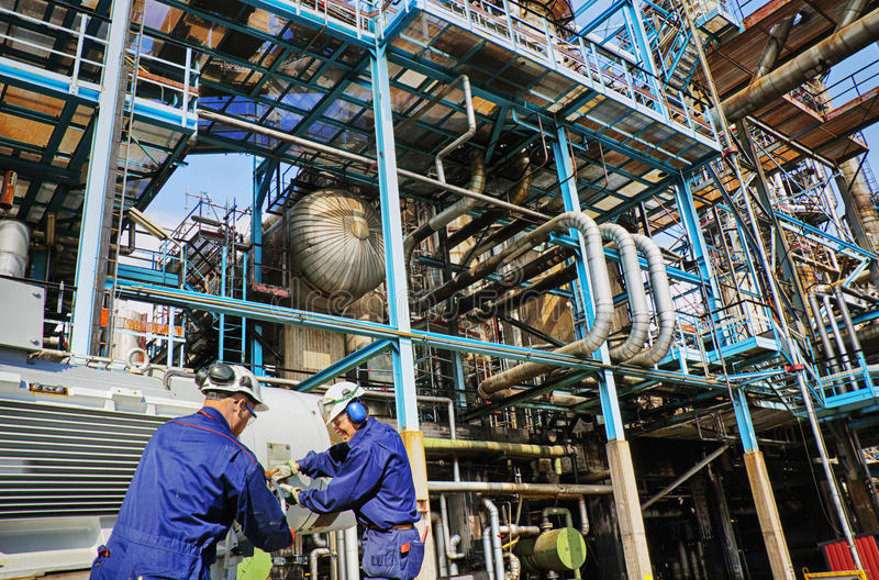 Industry workers inside oil and gas refinery stock image