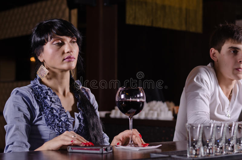 Inebriated Young Woman Sitting At A Bar Royalty Free Stock Photography