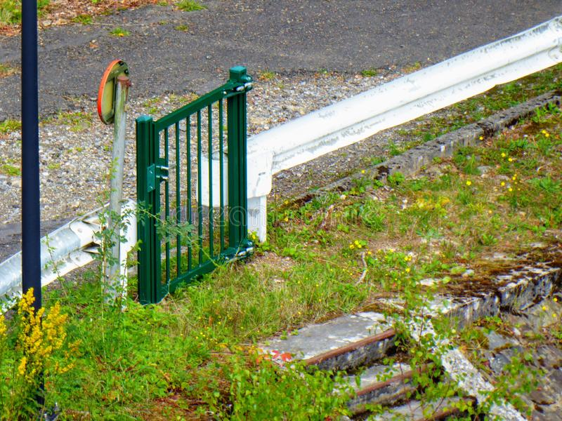Inefficient fence, stopping fence door that isn& x27;t effective. Garden path fencing. Inefficient fence, stopping fence door that isn& x27;t effective. Garden stock photo