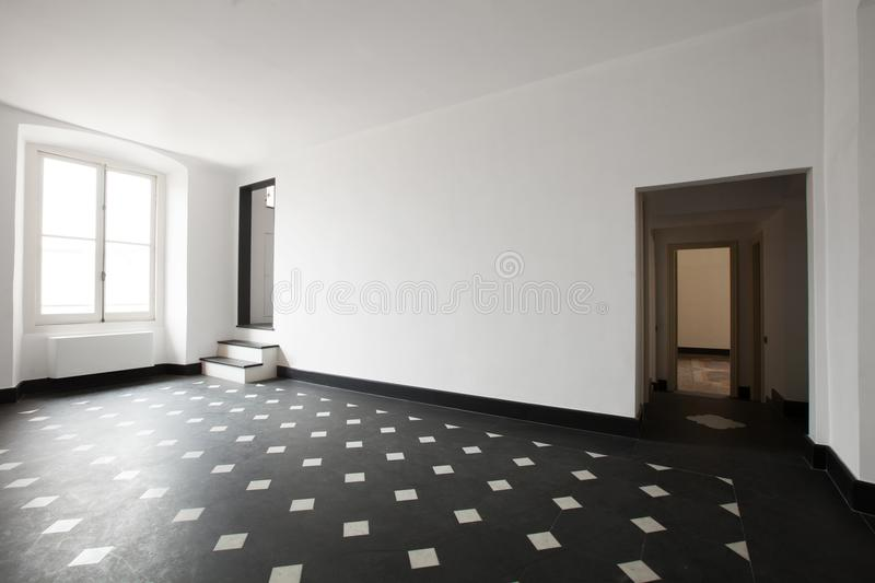 Empty room with black and white tile. Inerior house, empty room with black and white tile. White wall. Copy space royalty free stock photography
