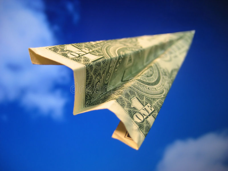 Inexpensive / Expensive Travel. A paper airplane created out of money