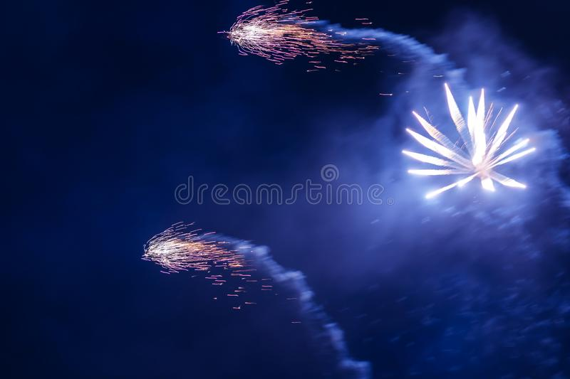 Inexpensive fireworks, over the city, red and blue. Celebration conept, Motion blur, For any purpose stock image
