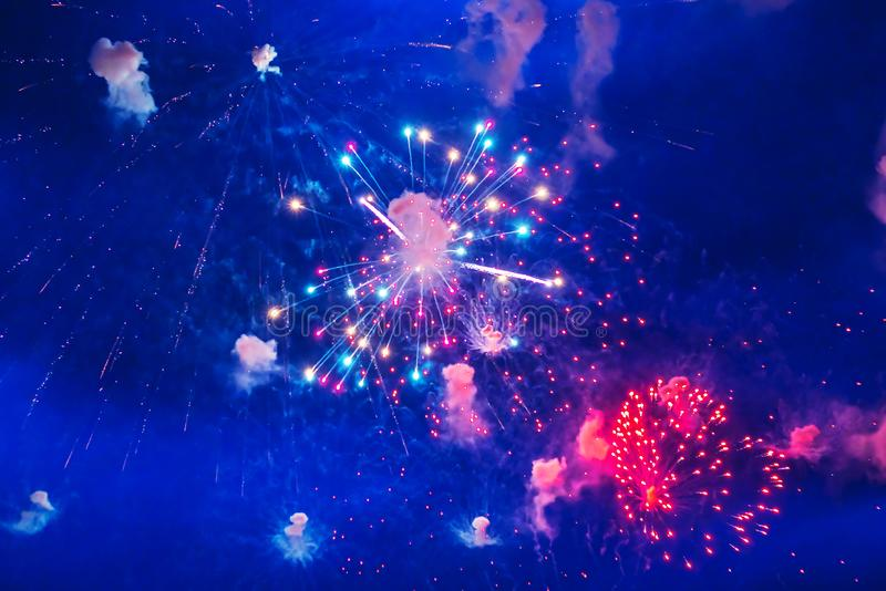 Inexpensive fireworks, over the city, red and blue. Celebration conept, Motion blur, For any purpose royalty free stock photo