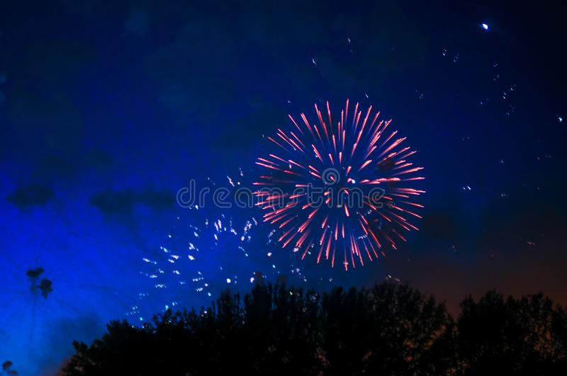 Very cheap firework over the city. royalty free stock photo