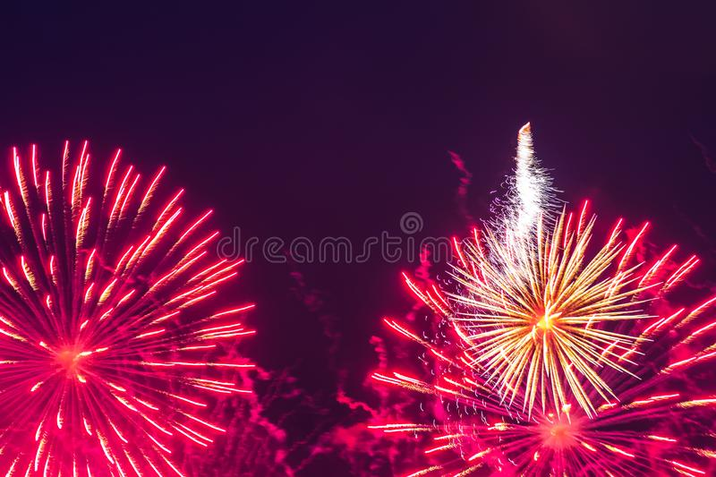 Inexpensive fireworks, over the city sky. Inexpensive fireworks, over the city, red and pink. Motion blur. Light flares. For any purpose stock photography