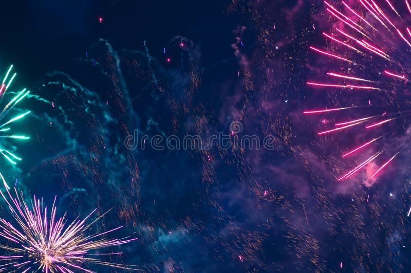 Inexpensive fireworks, over the city sky. Inexpensive fireworks, over the city, red, pink and green. Motion blur. Light flares. For any purpose stock image