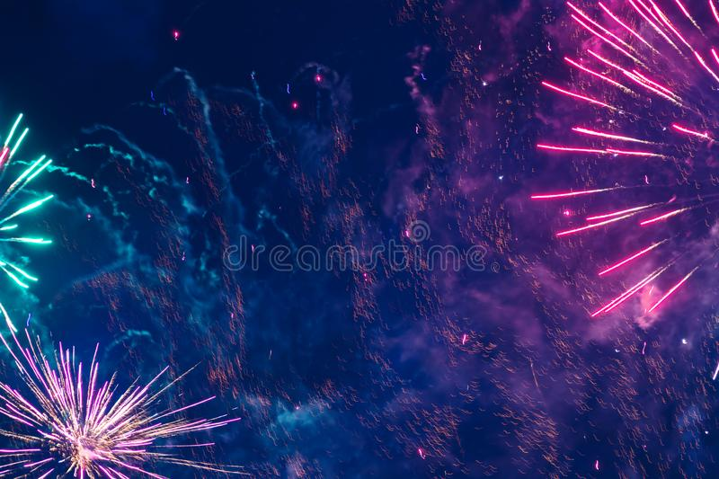 Inexpensive fireworks, over the city sky. Inexpensive fireworks, over the city, red, pink and green. Motion blur. Light flares. For any purpose stock photos