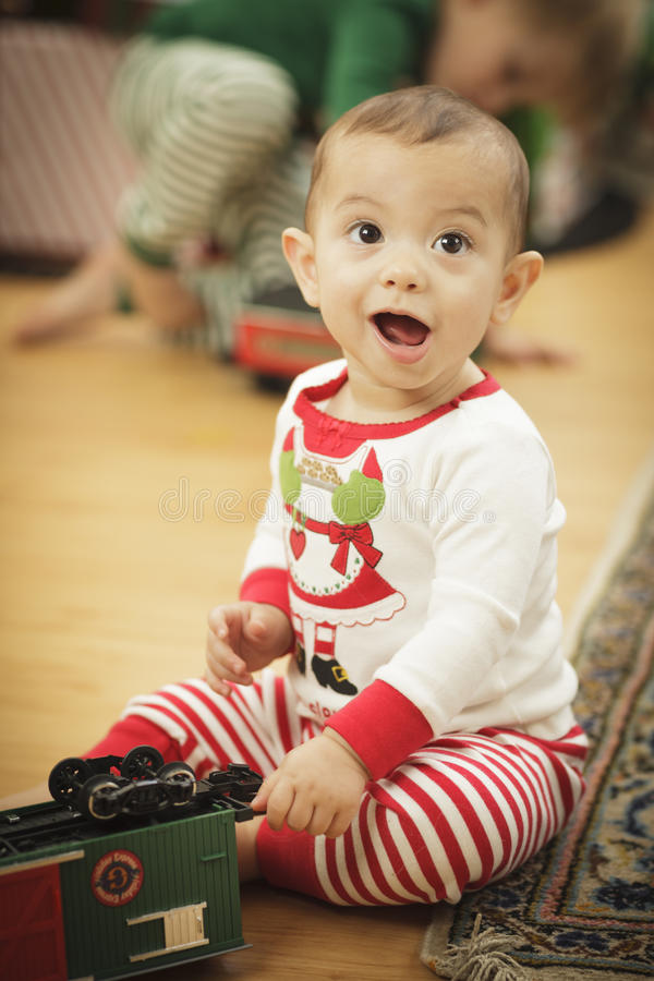 Download Infant Baby Enjoying Christmas Morning Near The Tree Royalty Free Stock Images - Image: 28150679