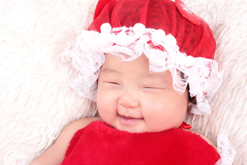 Infant baby girl smiling